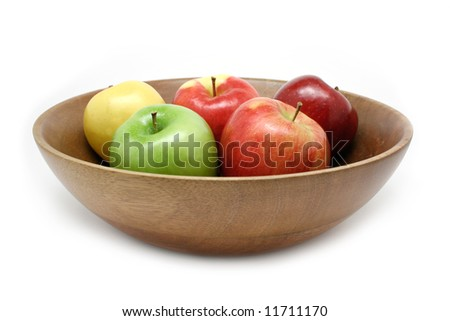 Colorful apple assortment in a wooden bowl isolated on white - stock photo