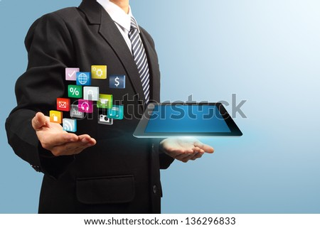 colorful application icon with tablet computer in the hands of businessmen, Business software and social media networking service concept - stock photo