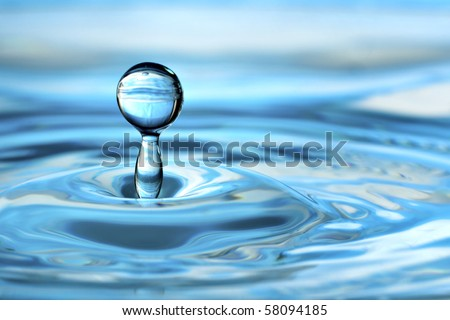 Colorful aqua blue green  water drop and splash - stock photo