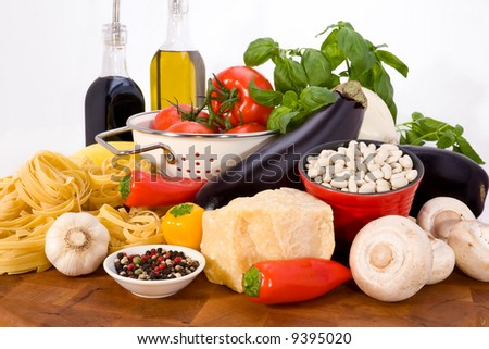 Colorful array of Italian ingredients for making fresh homemade meals. - stock photo