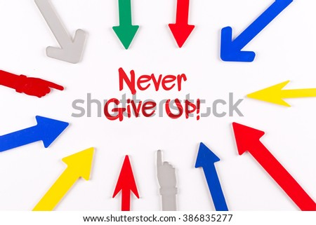 Colorful Arrows Showing to Center with a phrase Never Give Up! - stock photo