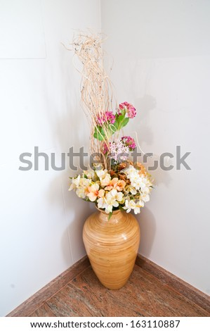 Colorful artificial flowers in vase - stock photo