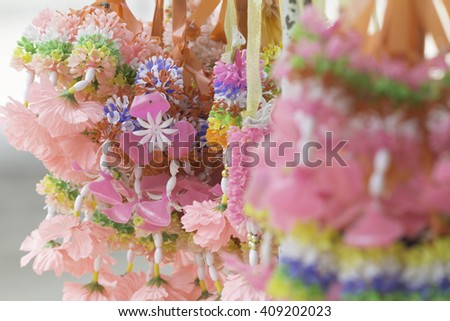 Colorful artificial garlands, Change the belief (blur effect). - stock photo