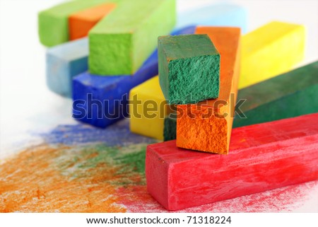Colorful artists pastels with scribbles on white paper.  Macro with extremely shallow dof. - stock photo