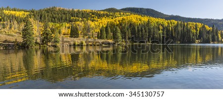 Colorful Aspens reflected in Lower Cataract Lake in the Arapaho National Forest in the Rocky Mountains of Colorado. - stock photo