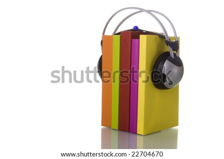 colorful audio book concept with headphones and books (isolated on white) - stock photo