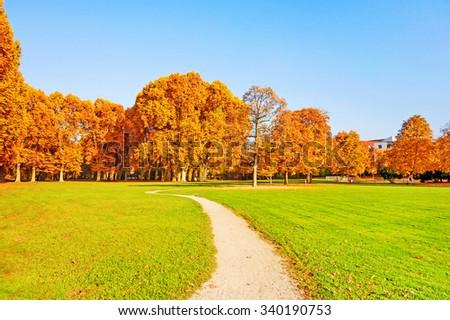 Colorful autumn landscape - vibrant trees in park Mittlerer Schlossgarten (Middle Castle Garden) in Stuttgart - stock photo
