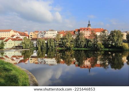 Colorful autumn medieval Town Pisek above the river Otava, Czech Republic  - stock photo