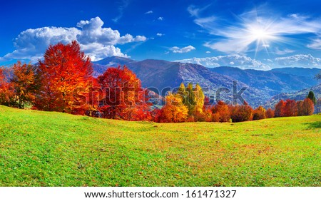 Colorful autumn panorama of the mountains - stock photo