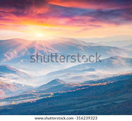 Colorful autumn sunrise in the Carpathian mountains. Vododilniy ridge, Ukraine, Europe - stock photo