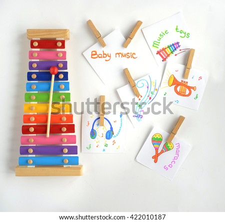 Colorful baby xylophone with stick isolated over white background. top view - stock photo