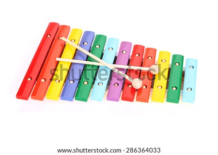 Colorful baby xylophone with two sticks isolated over white background - stock photo