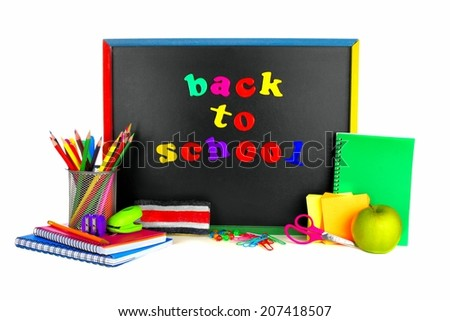 Colorful Back To School magnetic letters on a blackboard with school supplies - stock photo