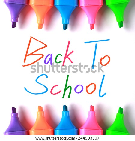Colorful back to school word with markers on white paper. - stock photo