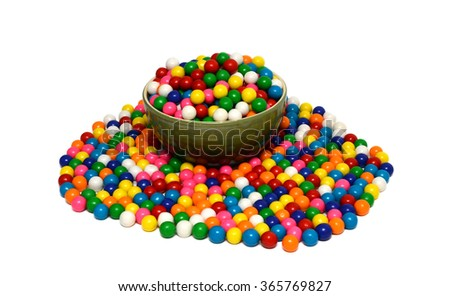 Colorful background of assorted shiny round gumballs with a bowl - stock photo