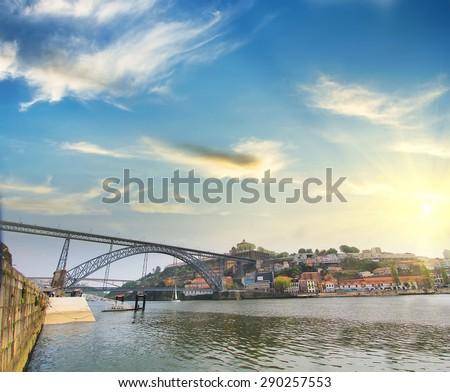 Colorful background,  view of Douro riverside with the Dom Luiz bridge , Porto , Portugal. Travel background - stock photo