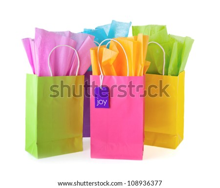 Colorful bags with paper and tag - stock photo
