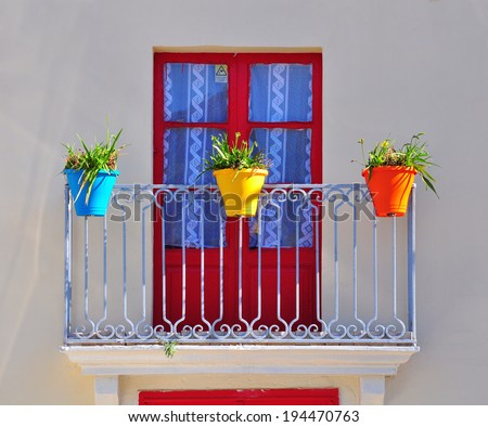 Colorful balcony of typical mediterranean house - stock photo