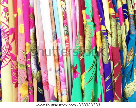 Colorful balinese cloth for sale, Ubud, Bali, Indonesia, Asia - stock photo