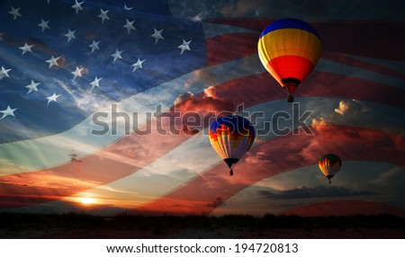 Colorful balloons flying at sunrise on the background of the USA flag - stock photo