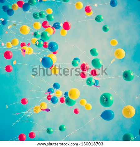 Colorful balloons in flight - stock photo