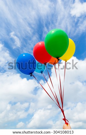 Colorful balloons in the blue sky - stock photo