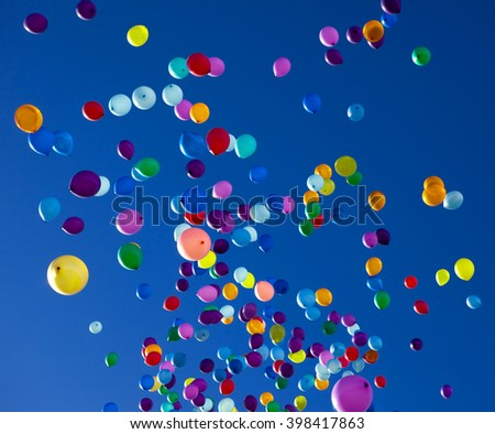 colorful balloons on a blue sky background - stock photo