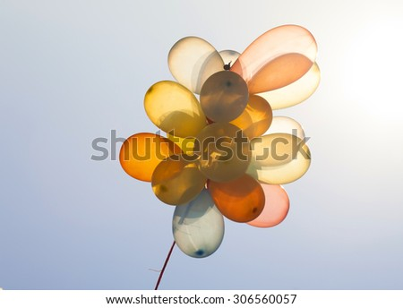Colorful balloons on blue sky. Concept of love in summer, valentine, wedding and honeymoon - stock photo