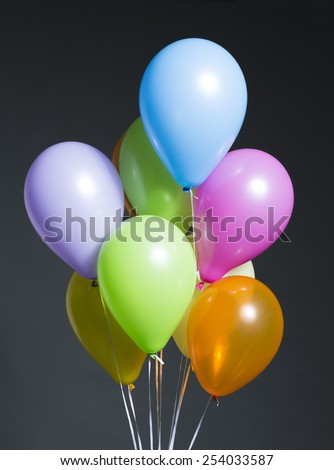 Colorful Balloons on Dark Background - stock photo