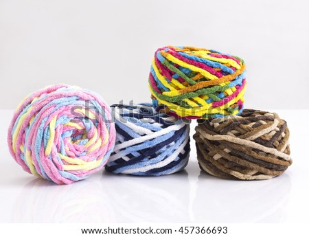 Colorful balls of woolen yarn isolated on white background - stock photo