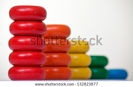 Colorful bar chart made from stacked wooden toys representing business report - stock photo