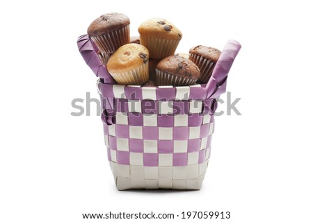 colorful basket full of little muffins variety on white background - stock photo