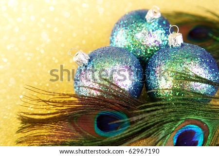 Colorful baubles with peacock feathers - stock photo