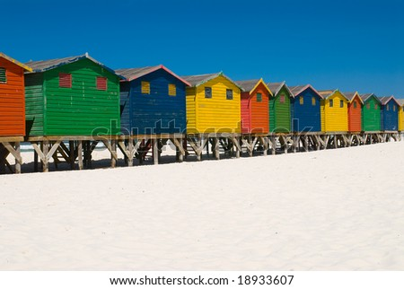Colorful beach huts in a row near cape town - stock photo