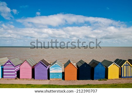 Colorful beach huts in Herne Bay in England - stock photo