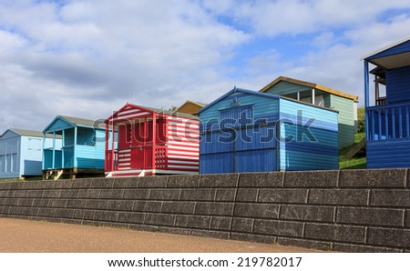 Colorful beach huts in Whitstable, a seaside town in Kent, UK - stock photo