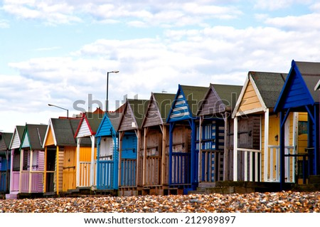 Colorful beach huts on the beach in EnGLAND - stock photo