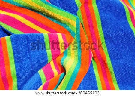 Colorful beach towel useful as a background pattern - stock photo