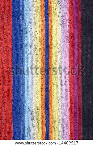 Colorful beach towel with vertical stripes - stock photo