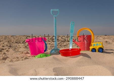 Colorful beach toys under blue sky on summertime - stock photo