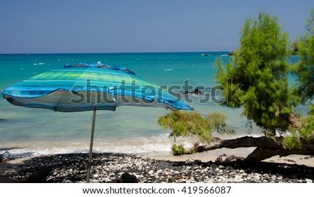 Colorful beach umbrella at Wailalea Beach, Big Island, Hawaii - stock photo