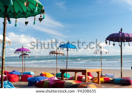 Colorful beach umbrellas and pillows in Kuta, Bali - stock photo
