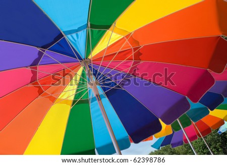 colorful beach umbrellas on sunny day - stock photo