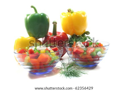 colorful bell pepper salad with dill in small glass bowl - stock photo