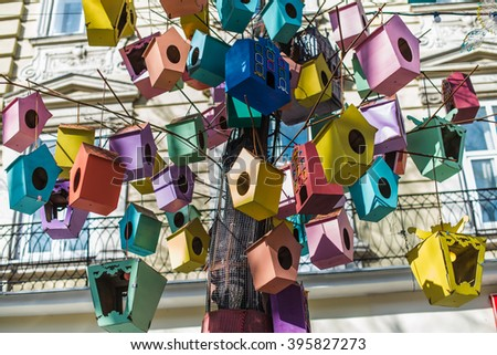 Colorful bird feeders hanging on the tree close up - stock photo