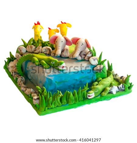 Colorful birthday celebration cake decorated with figures of animals for kids party - stock photo