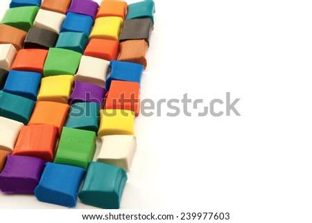 Colorful blocks of plasticine isolated on white. - stock photo
