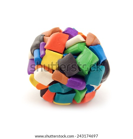 Colorful blocks of plasticine molded together in a sphere over white background. - stock photo