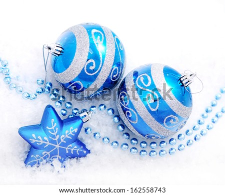 Colorful blue christmas decoration baubles on white with space for text. (shallow DoF) - stock photo