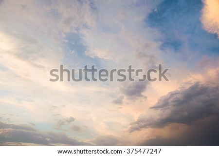 Colorful blue sky background with white clouds on sunset. Blue clear sky panorama with vivid clouds and sun rays.  - stock photo